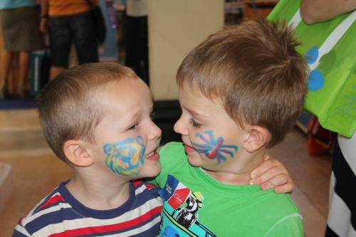 Face painting on the boys, Ethan and Oliver