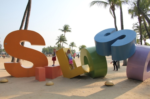 Isabelle and Oliver on the Silosa Beach letters