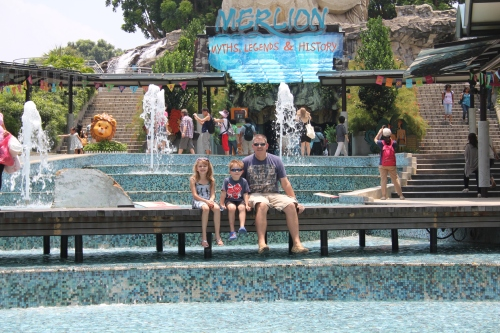Sitting on the water feature by the Merlion