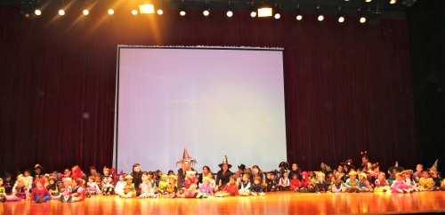 A full stage - 3 reception classes and 5 nursery classes in costume!