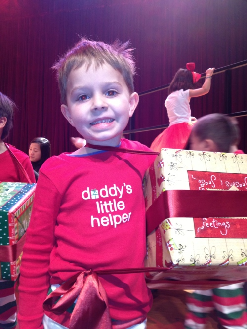 Oliver's class were Christmas presents and he was wearing a lovely top underneath.  His costume was a surprise!