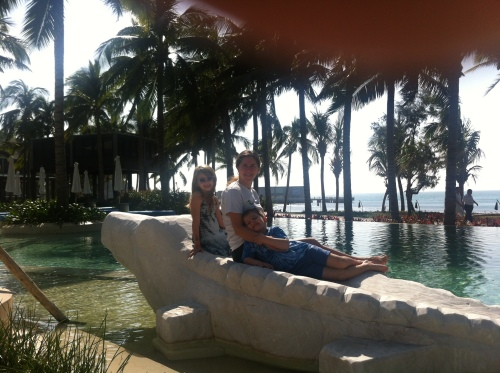Lazing on the alligator in the Club pool.