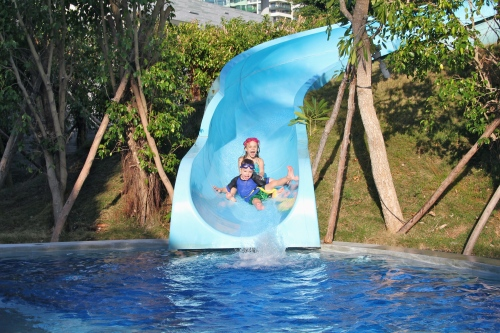 The water slide at the family pool.