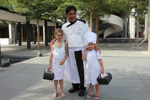 Chef Alex with his Sous Chefs!  The boxes contain cookies and muffins that they made in the restaurant kitchen.  They loved this!