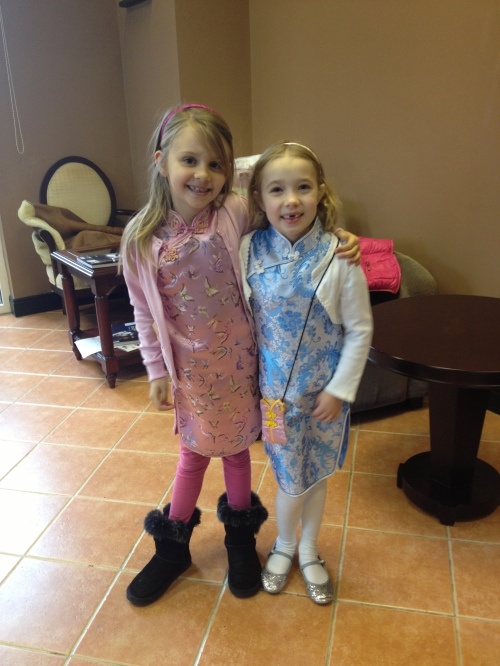 Chinese New Year celebrations at BISS.  Isabelle and Ava dressed in traditional Chinese dresses.