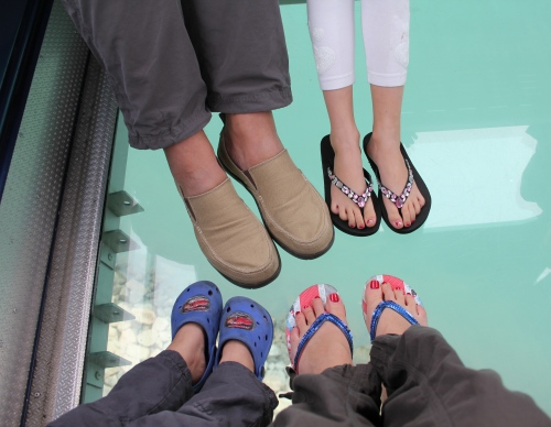 Family Jones feet!  Looking through the bottom of our cable car to the ocean below.