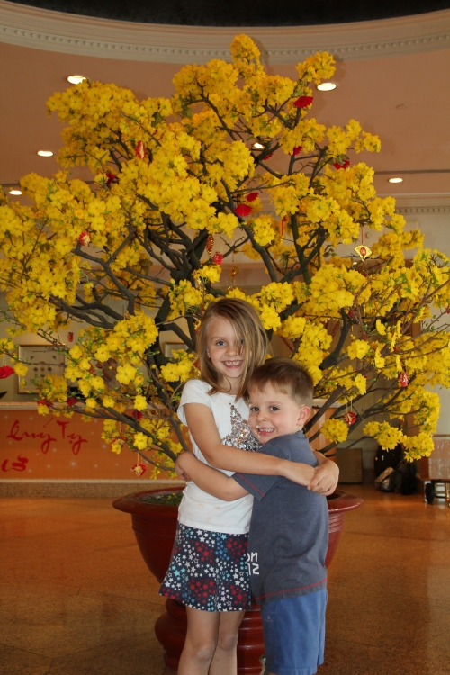 Beautiful flower display in the hotel lobby.  With 2 beautiful children!