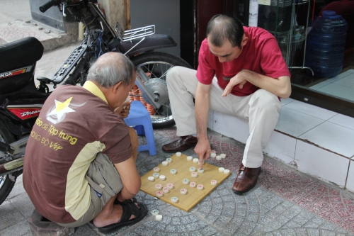 Local Vietnamese playing games out on the street.
