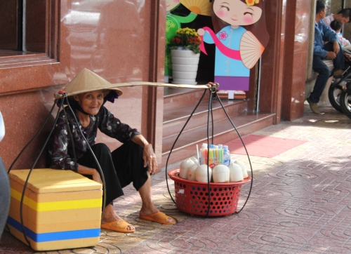 This lady was trying to get us to buy her wares.  She looks so fragile and the buckets look so heavy.  No wonder she is sitting.