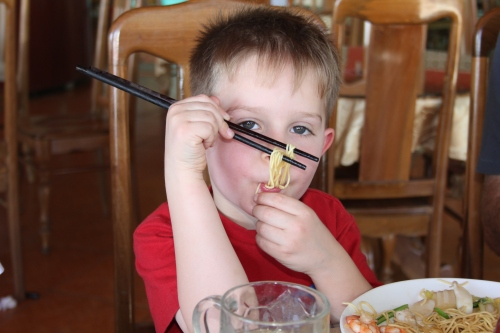 Oliver is getting used to chopsticks and is getting quite good with them!