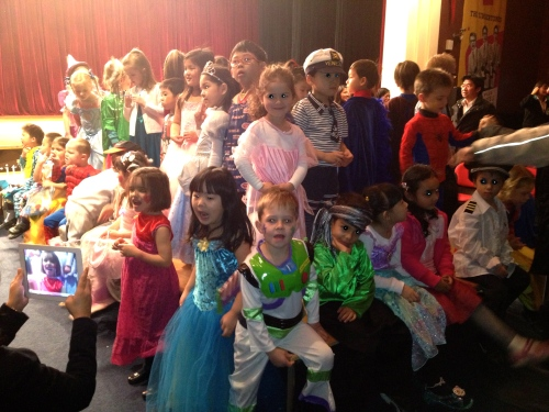 3 Reception Classes up on the Catwalk.  Lots of princesses and fairies for the girls and super-heros for the boys!