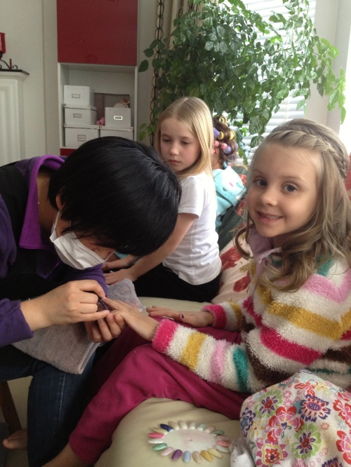 Phoebe painting Isabelle's nails!