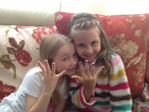 Ava and Isabelle showing off their painted nails.