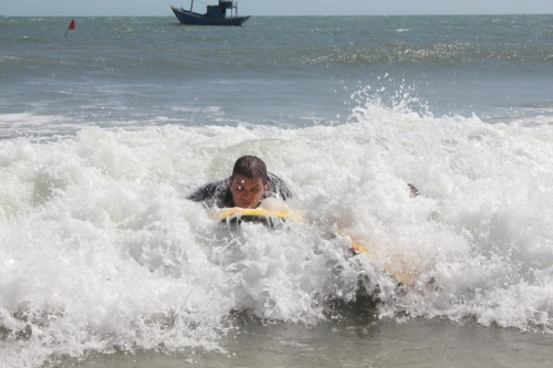 Owen riding a wave.