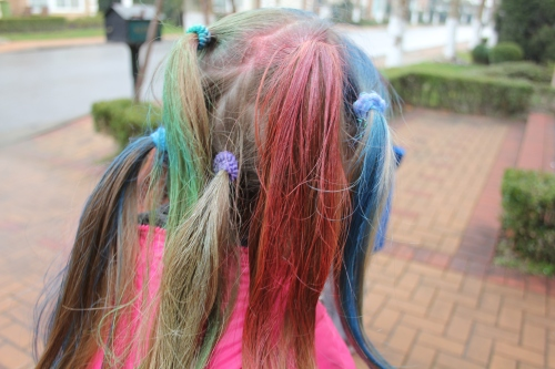 Multiple pony tails and lots of colour.