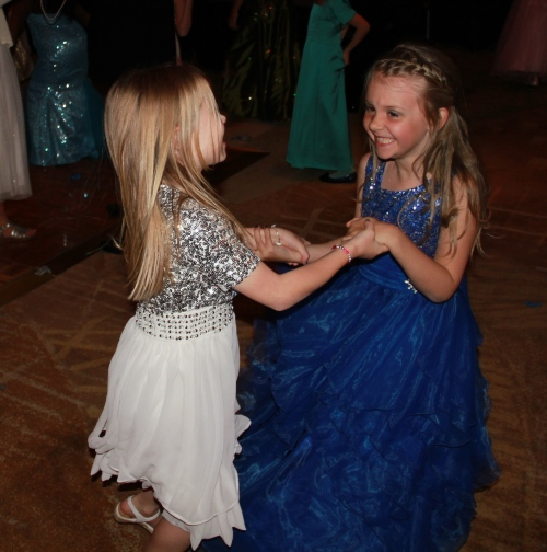 Girls on the dance floor together.