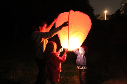 Lighting the lantern - it took several minutes to fill with warm air.