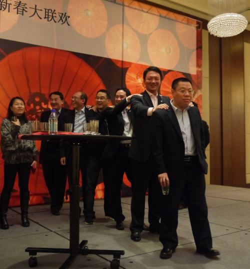This drinking game involved a large glass of Baijiu and glasses of water.  The goal was to guess who was drinking the alcohol!