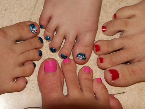 Nails, nails, nails.  Isabelle (Flower) and Ava (Rose), Emma (Red) and Sara (Pink)