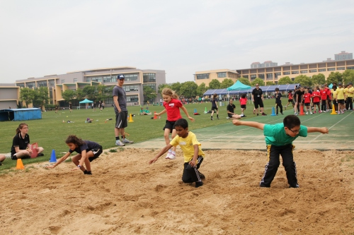 Long jump - she had several go's at this one and got better with each attempt.