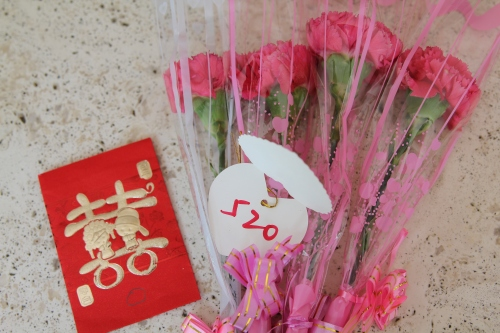 The lucky red ticket, flowers and red envelope.