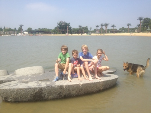 All of the kids - Luke, Oliver, Dan and Isabelle, sitting in a rock boat!