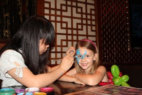 Isabelle getting her face painted at the Kerry Parkside Brunch - children's area.