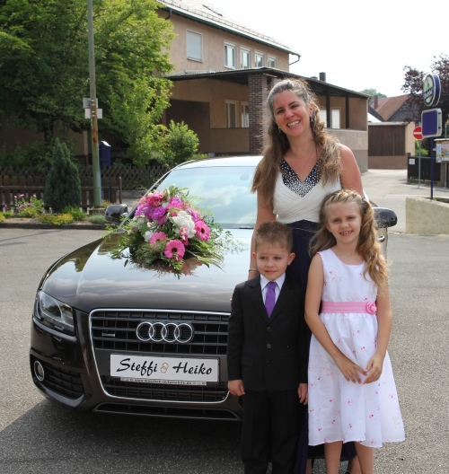 Posing by the wedding car.  The flowers made it to the church, lake and reception!
