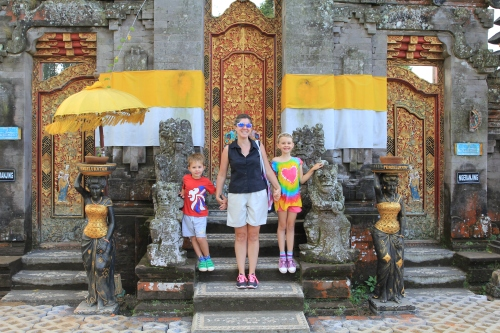 Most of the Temples in Bali have an inner and outer area.  We could walk around the outer area, but were not allowed inside.  Here we are on the steps.