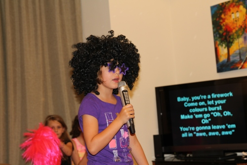 Maddie in the middle of a Katy Perry rendition!