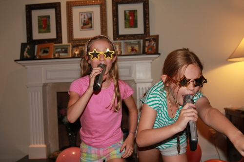 Emma and Lia in the Karaoke sing off!