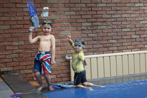 Oliver and Joseph firing off the water pistols!