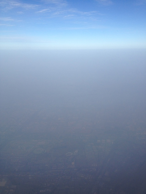 Clear blue sky above the smog.  This should have been a fantastic view for me across the city.