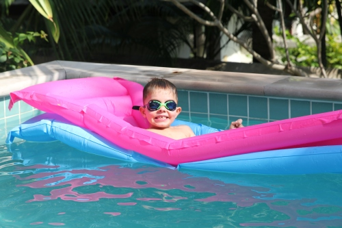 "Oliver relaxing in the pool at our villa.  ""This is the life, Mum!"""