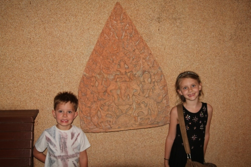 Oliver & Isabelle by a wall sculpture in the Spirit House Restaurant