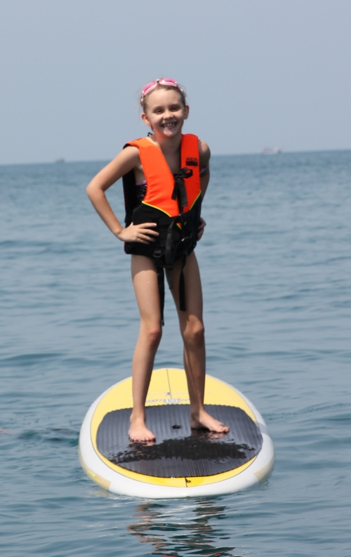 Isabelle standing up on the Paddle Board.  Did not last long!!