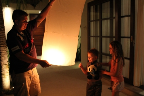 Isabelle and Oliver watching Daddy make sure that the Chinese Lantern is full before letting go.