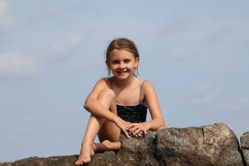 Isabelle as Queen of the Castle on the rocks.