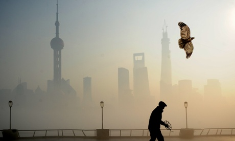 Look at this famous skyline from just across the river.  Smog is low and thick.  Many days seem to be like this in Shanghai now.