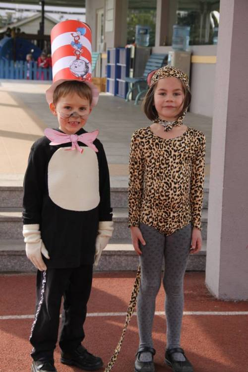 Oliver - winner of the Boys Best Costume posing with his girlie counterpart!  Glad to see he is smiling this time.  Photo is courtesy of BISS.