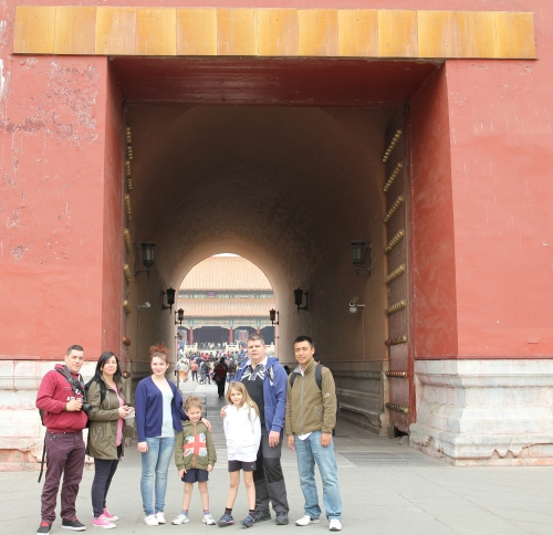 Standing by 1 of the main entrances into the Forbidden City.  The red doors are huge and very thick.
