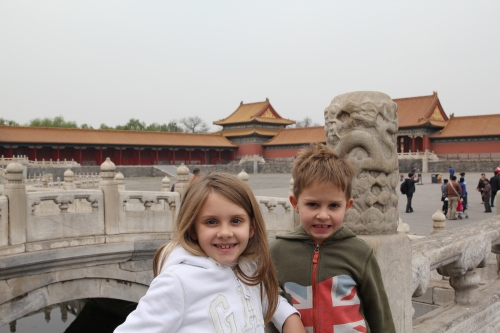 Isabelle and Oliver on the bridge in front of the Supreme Harmony Hall.