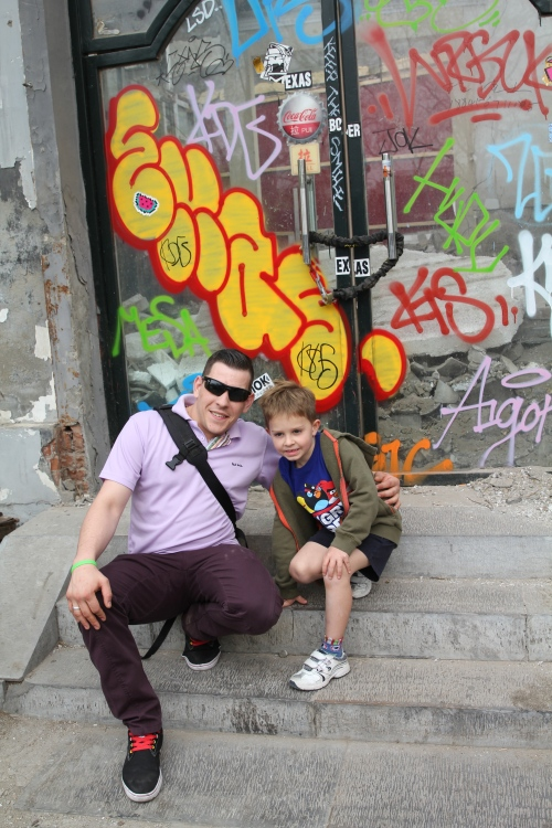 Ashley & Oliver by a Hutong that is designated for demolition.