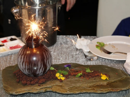 The arrival of the Chocolate Bomb dessert.