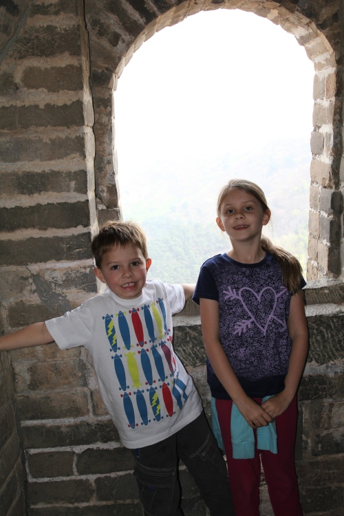 Oliver & Isabelle by one of the windows in a watch tower.