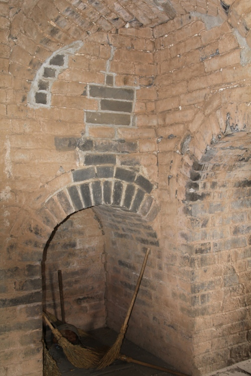 Fire was used to signal to other watch towers, so when the guards/soldiers wanted to eat or stay warm, they had to light fires in chimneys like this one.  It would have been incredibly smokey in here!