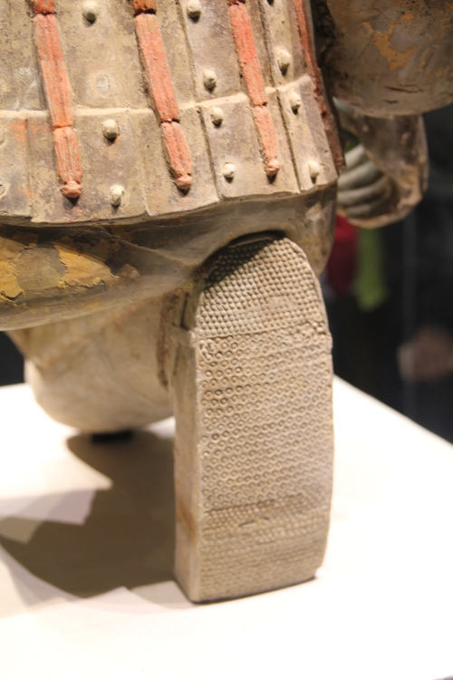 The back of the kneeling archer.  Some of the colour has been preserved and you can also see the detail on the shoes.