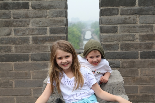 Isabelle & Oliver on the top of the City Wall, and looking through to the City.