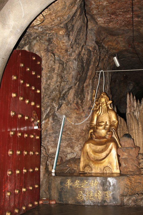 Inside of the huge stone hill are caves, with stone carvings, statues and walkways.