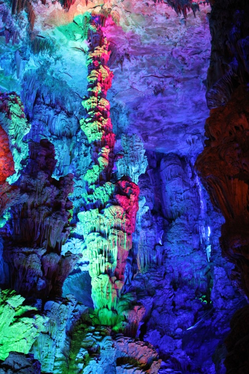 The beautiful lighting against the fabulous stalagmites and stalactites.